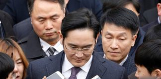 FILE PHOTO - Samsung Group chief, Jay Y. Lee, leaves after attending a court hearing to review a detention warrant request against him at the Seoul Central District Court in Seoul