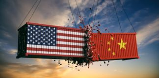 USA-and-China-trade-war.-US-of-America-and-chinese-flags-crashed-containers-on-sky-at-sunset-background.-3d-illustration-Illustration