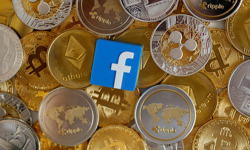 Facebook logo is seen on representations of virtual currencies in this illustration picture